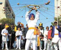 A child performing martial arts during a Nagar Kirtan