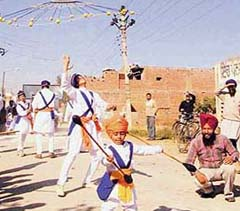Children display their skill in martial arts during a Nagar Kirtan at Ahmedgarh