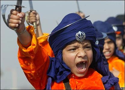 Children shout during a procession in Jammu, India